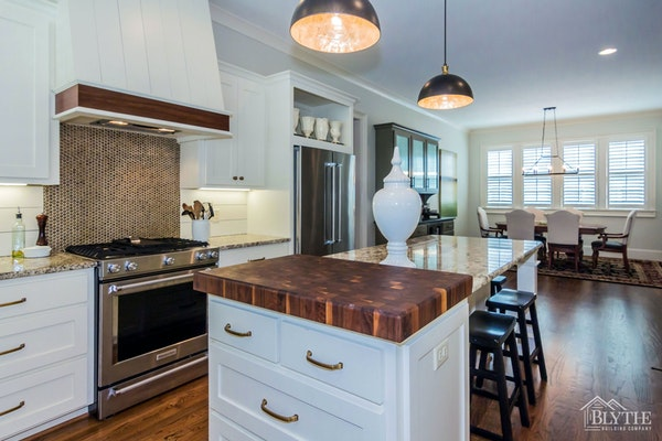 Butcher block countertop insert in kitchen island|Blythe Building Company