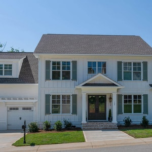 Luxury home with board and batten exterior siding