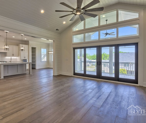 Shiplap wall and ceiling with wall of windows and glass doors