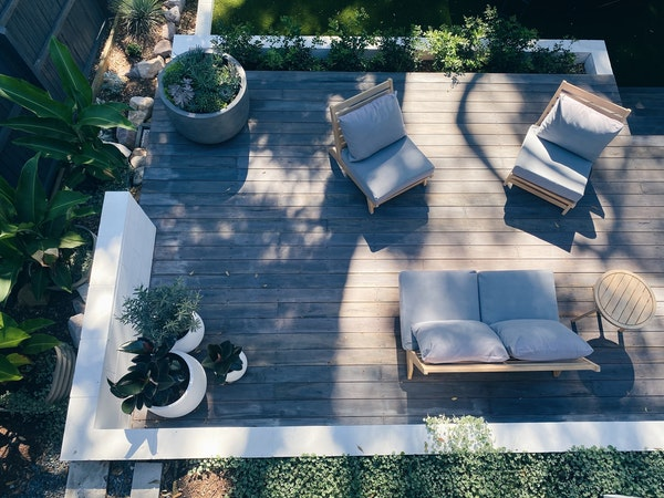 overhead shot of a deck with furniture and planters