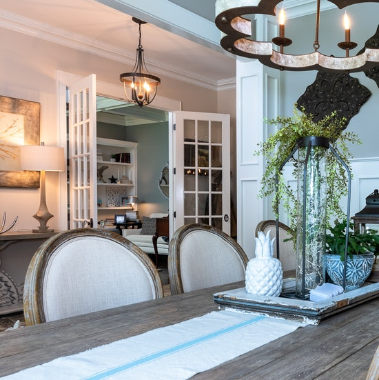 beautiful-luxury-dining-room-with-custom-wood-molding-and-wooden-table