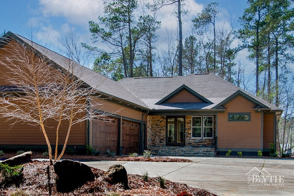 Custom Home With 4 Car Garage Stacked Stone Accents And Cedar Shingle Panel Accents = New Home in Lexington, SC