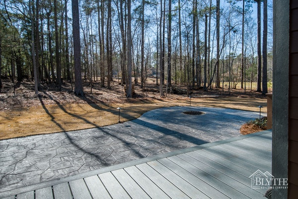 Composite Deck And Stamped Concrete Patio With Sunken Fire Pit