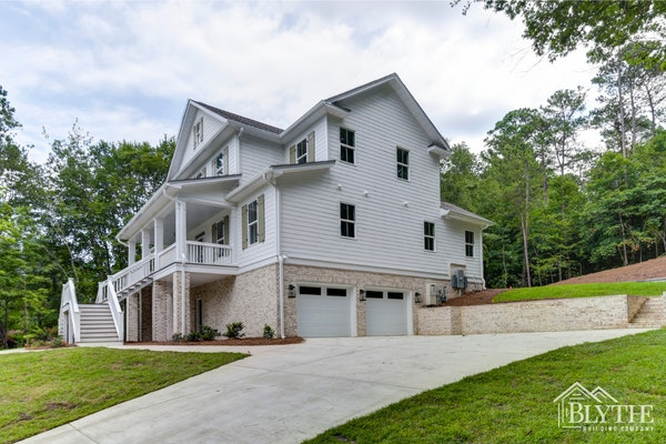 Exterior view of 3-Story Multigenerational Home With Split Front Staircase To Porch And Double Car Garage In Basement