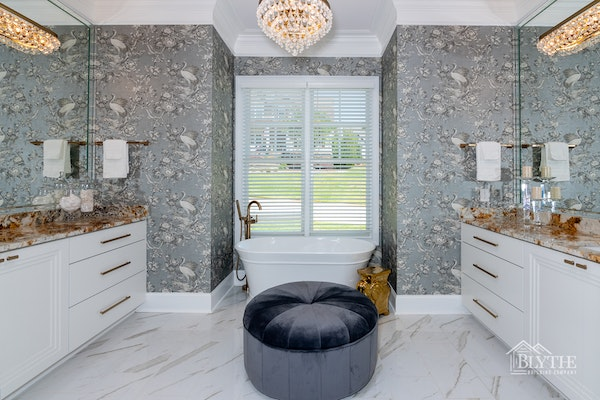 Maximalist bathroom with wallpaper and chandelier
