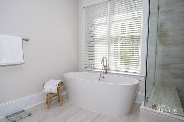 farmhouse-chic-bathroom-with-stand-alone-sculpted-tub.jpg