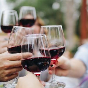 close-up-of-people-holding-wine-glasses-for-a-toast.jpg