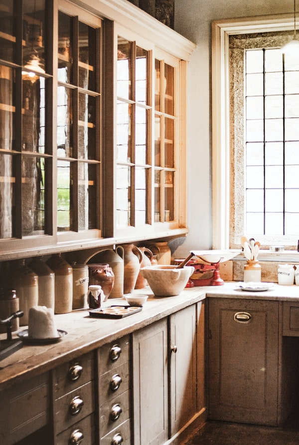 Walk-in scullery with cabinets and counter space