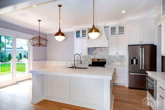 White kitchen cabinets and Cosmos Super White Quartz Countertop 3cm for the kitchen island