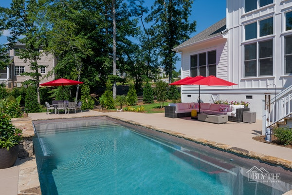 Custom in-ground pool and patio area behind custom Craftsman home in Lexington, SC
