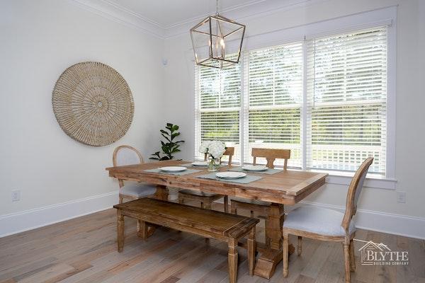 farmhouse-chic-dining-room-hardwood-floors-large-pendant-light.jpg