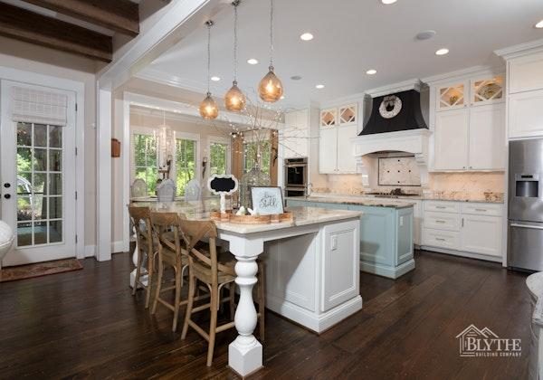 Double kitchen islands with pendant lighting