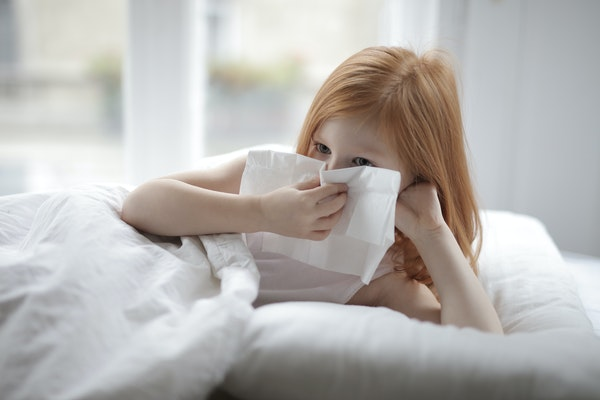red-headed-girl-in-white-bed-with-tissue