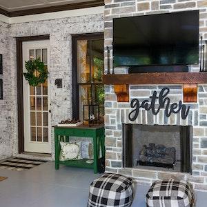 Reclaimed wood beam fireplace mantel|Blythe Building Company