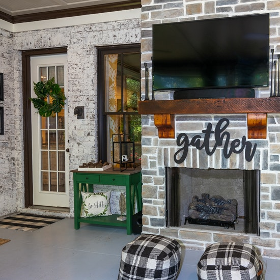 Reclaimed wood beam fireplace mantel|Blythe Building Company