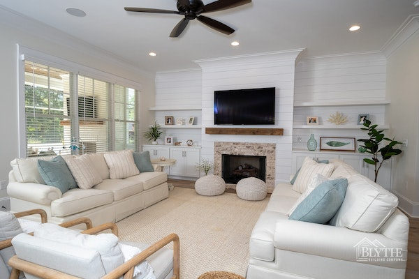 farmhouse-chic-living-room-with-shiplap-and-brick-fireplace.jpg