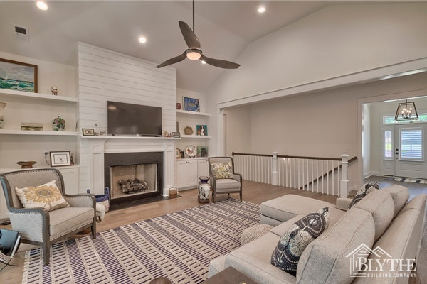 White Shiplap Fireplace Wall With White Mantel And Custom Built In Bookshelves And Cabinets On Each Side Of The Fireplace 1