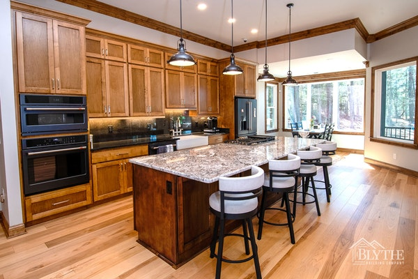 Custom Kitchen With Large Island Wood Cabinets Heavy Wood Molding And Hardwood Floors