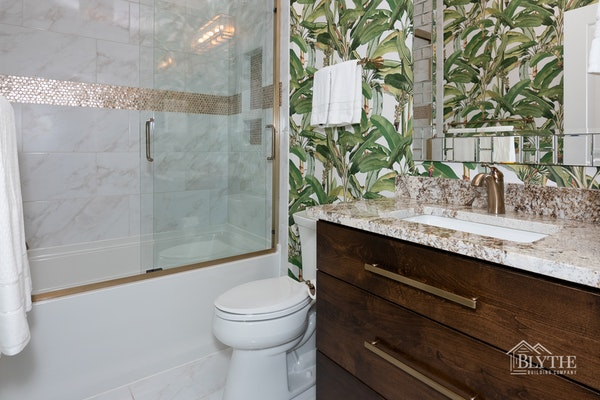 Maximalist bathroom with tropical wallpaper