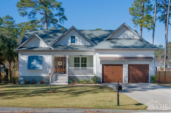 Modern Craftsman-style home with gables and board and batten siding accents