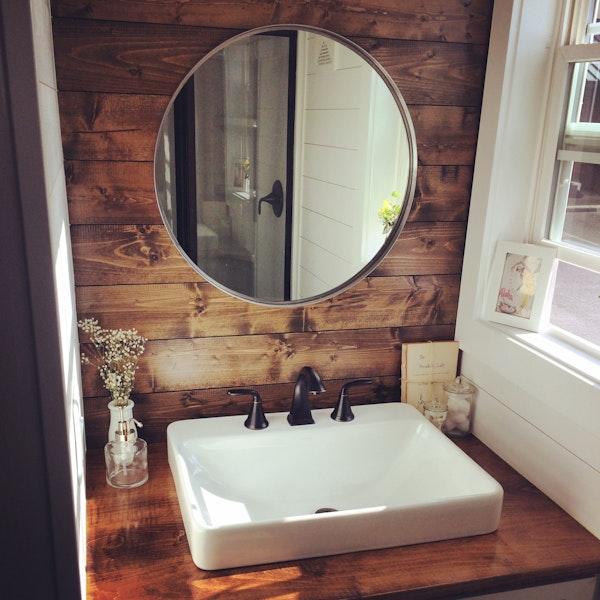 Rustic shiplap wall in bathroom