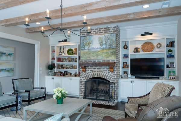 Exposed Beams and rustic brick fireplace and fireplace wall