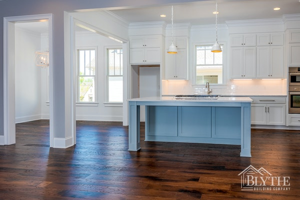 Spacious Kitchen With Board and Batten Kitchen Island