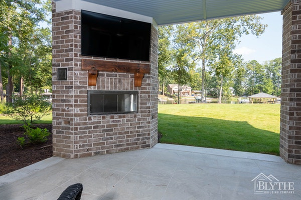 Backporch With Fireplace And Tv