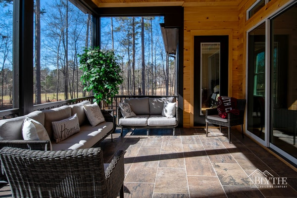 Pine shiplap siding on a screened-in back porch