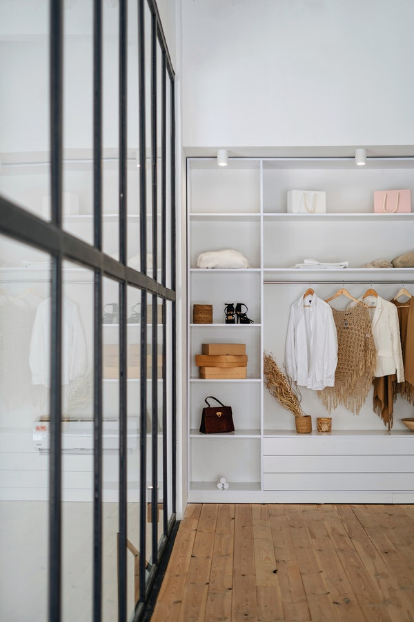 modern, large, white walk-in closet with mirrors
