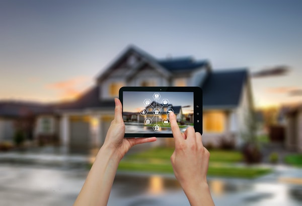 Luxury-home-at-twilight-and-smartphone-with-smart-home-technology.jpg