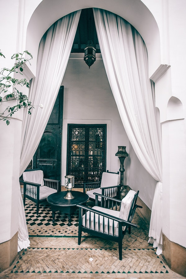 Patio pavers in luxury patio with dramatic white archway and curtains