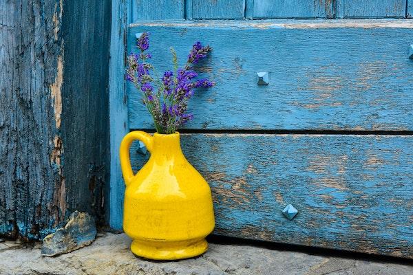 Shabby-chic-farmhouse-decor-yellow-vase-purple-flowers-distressed-blue-dresser.jpg