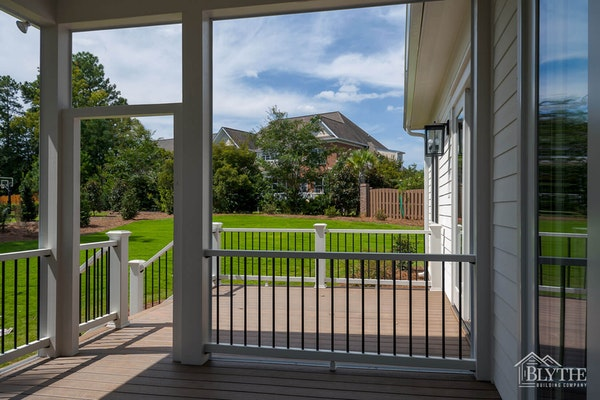 Screened-in-back-porch-with-green-yard-in-subdivision.jpg