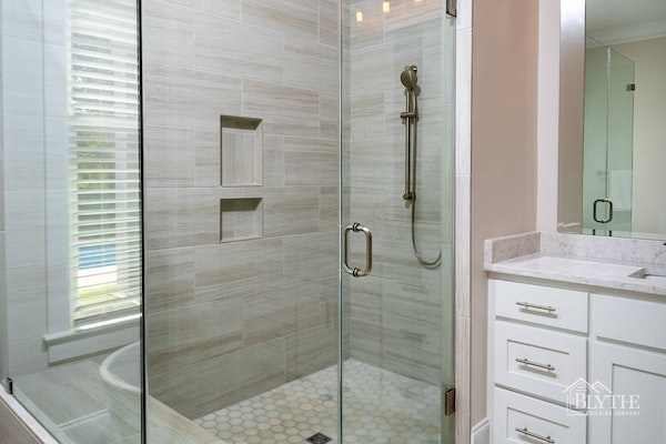 Oversized custom shower with glass enclosure