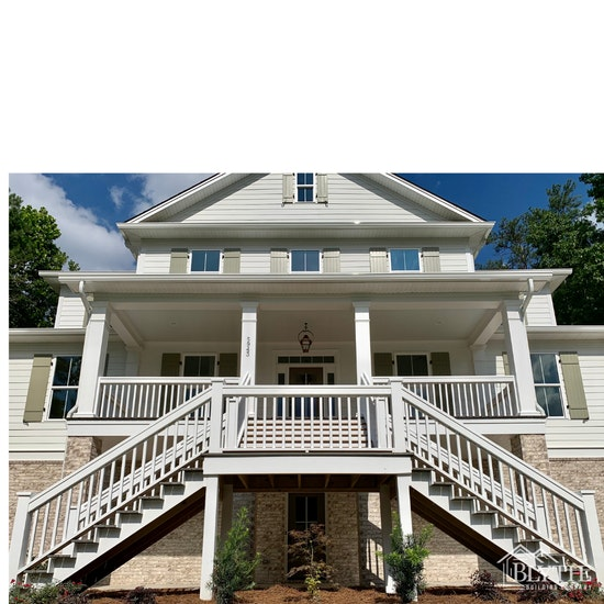 Exterior new custom home split staircase and board and batten shutters