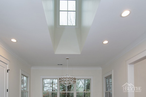 Eating Area With Vaulted Ceiling And Dormer Window 1