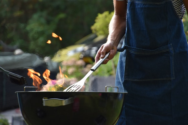 man-grilling-with-spatula-and-charcoal-grill.jpg