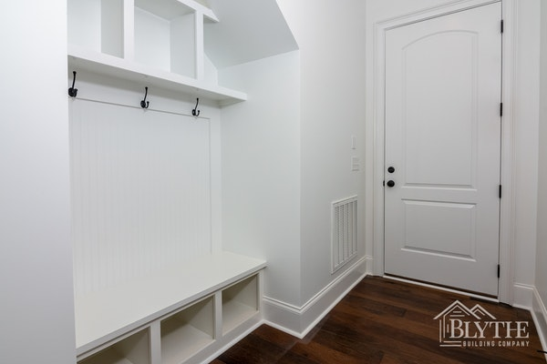 Beadboard in a mudroom with built-in bench and cubbies