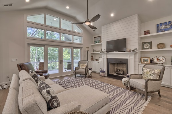 Living Space With Vaulted Ceiling And Wall Of Windows 1