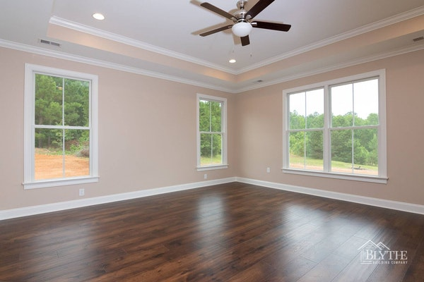 Custom master bedroom with lighted tray ceiling and ceiling fan