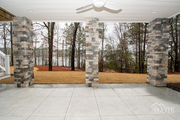 Stacked Stone Columns For Patio Under Deck With Lake View 1