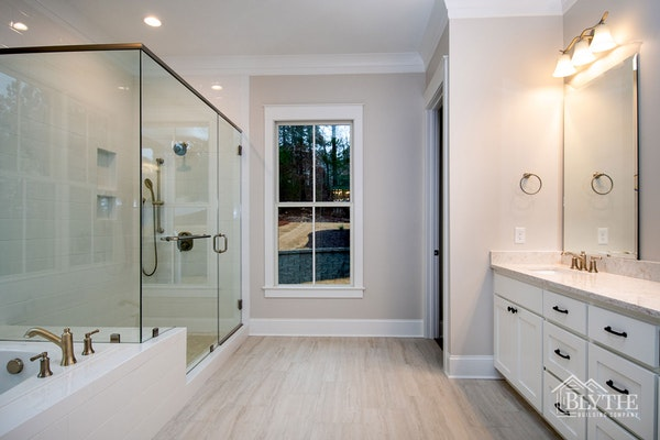 Custom Luxury Bathroom With Oversized Glass Shower And Separate Tub
